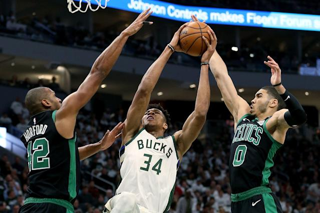 Al Horford (L) and Jayson Tatum make life tough for Giannis Antetokounmpo in the third quarter of Game 1 on Sunday. (Getty Images)