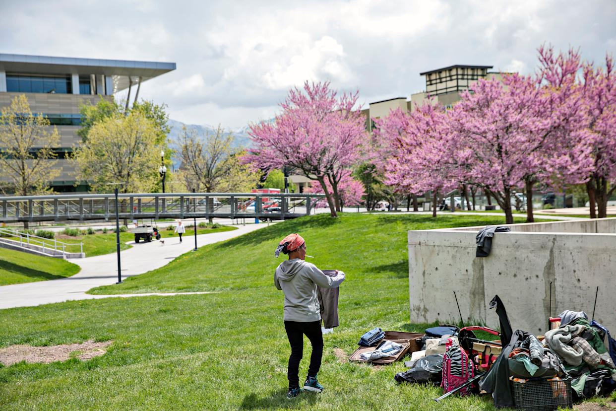 Dorriane Olson, 47, organizes her belongings in the courtyard at Library Square on May 1, 2019, in downtown Salt Lake City. Olson works a job overnight and tries to sleep during the day. She says she's been on a waiting list for housing for two years. (Photo: Kim Raff for HuffPost)