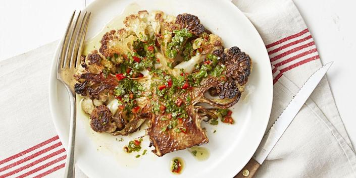 """<p>We're giving the classic Argentinian steak dish a lightened-up, vegetarian makeover ... and the results are fabulous. </p><p><em><a href=""""https://www.goodhousekeeping.com/food-recipes/healthy/a35231/chimichurri-cauliflower-steaks/"""" rel=""""nofollow noopener"""" target=""""_blank"""" data-ylk=""""slk:Get the recipe for Chimichurri Cauliflower &quot;Steaks&quot; »"""" class=""""link rapid-noclick-resp"""">Get the recipe for Chimichurri Cauliflower """"Steaks"""" »</a></em> </p>"""