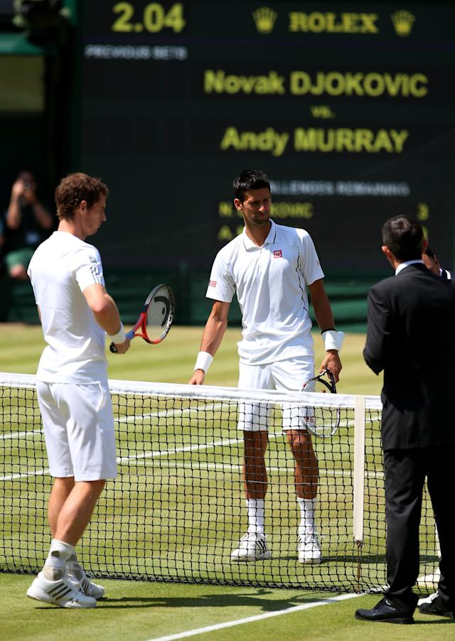 LONDON, ENGLAND - JULY 07: Andy Murray of Great Britain and Novak Djokovic of Serbia stand at the net on Centre Court before their Gentlemen's Singles Final match on day thirteen of the Wimbledon Lawn Tennis Championships at the All England Lawn Tennis and Croquet Club on July 7, 2013 in London, England. (Photo by Julian Finney/Getty Images)