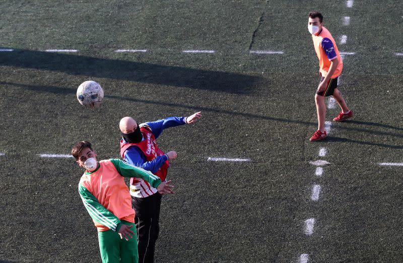 Argentines get soccer kicks at social distance with 'human foosball'