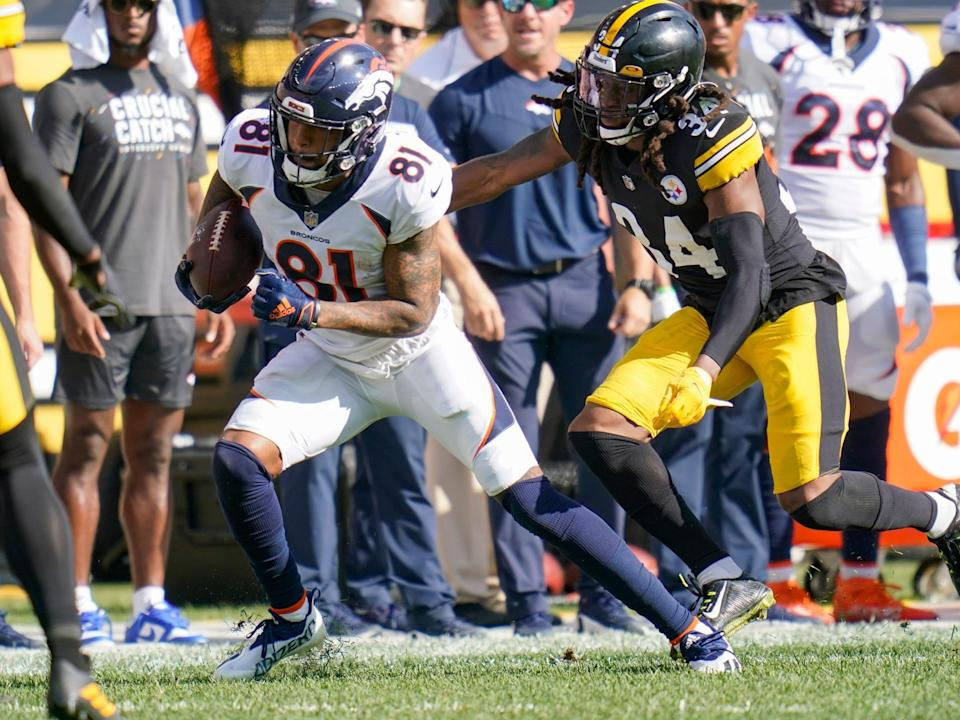 Tim Patrick pushes forward against the Pittsburgh Steelers.