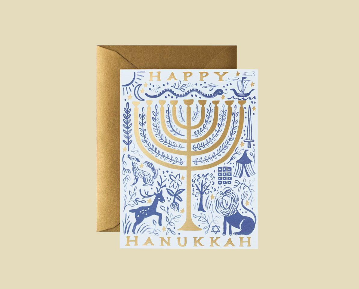 """<p>One of our editors' favorites, Rifle Paper Co. offers this whimsical blue and white illustration in their signature style to wish friends and family a happy Hanukkah. A blank interior lets your handwritten note take center stage.</p> <p><strong><em>Shop Now:</em></strong><em> Rifle Paper Co. """"Twelve Tribes"""" Menorah Greeting Cards, $18 for 6, </em><a href=""""https://riflepaperco.com/twelve-tribes-menorah-greeting-card""""><em>riflepaperco.com</em></a><em>.</em></p>"""