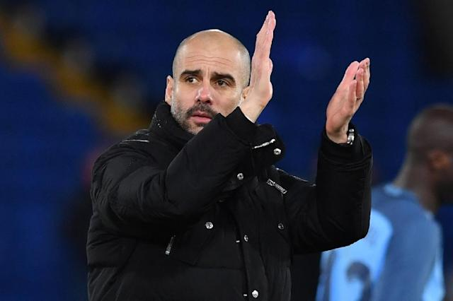 Manchester City's Spanish manager Pep Guardiola applauds at the end of the English FA Cup fourth round football match against Crystal Palace January 28, 2017 (AFP Photo/Ben STANSALL)