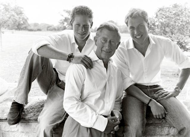 From left, Prince Harry, Prince Charles and Prince William pose for Charles' personal Christmas card in 2004, taken by Mario Testino in the grounds of Highgrove House. [PA]