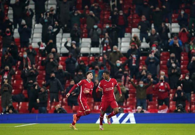 Georginio Wijnaldum, right, celebrates scoring Liverpool's second goal in a 4-0 win over Wolves on December 6. The game was notable for the return of fans, with 2,000 Reds supporters at Anfield to watch their club for the first time as Premier League champions. Games soon returned to being played behind closed doors after England entered another lockdown following Christmas