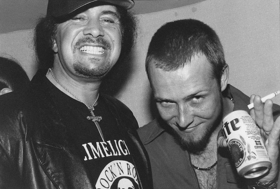 <p>KISS singer and guitarist Gene Simmons poses backstage with Stone Temple Pilots singer Scott Weiland at Rock for Choice benefit at Hollywood Palladium in April 1993 in Los Angeles, California.</p>