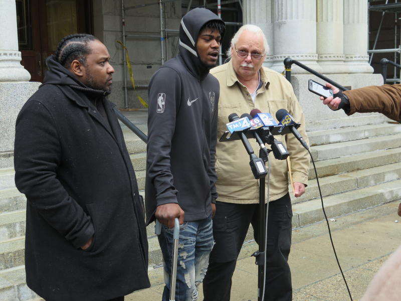 "In this Nov. 29, 2018 photo, Jerry Smith speaks during a news conference in front of the federal courthouse in Milwaukee. Shot by police in August 2017, his right leg is partially paralyzed. Smith wasn't charged with a crime and has a pending federal lawsuit against the police, alleging officers acted ""with deliberate indifference."" ""I had my hands up. It's on them,"" Smith says. At left is Tory Lowe, a community activist supporting Smith's cause, and at right is Daniel Storm, a private investigator working on Smith's case. (AP Photo/Ivan Moreno)"