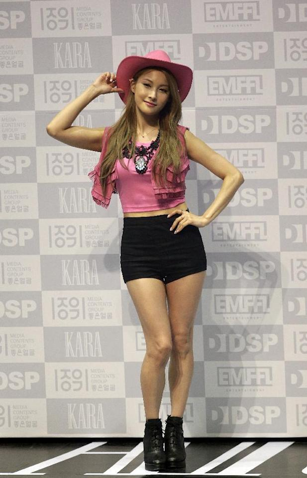 """South Korean K-Pop girl group KARA's member Park Gyu Ri poses for the media during a showcase for their new album """"In Love"""" in Seoul, South Korea, Tuesday, May 26, 2015. (AP Photo/Lee Jin-man)"""