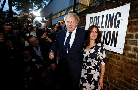 FILE PHOTO: Former London Mayor Boris Johnson and his wife Marina Wheeler arrive to vote in the EU referendum, at a polling station in north London, Britain June 23, 2016.      REUTERS/Peter Nicholls/File Photo