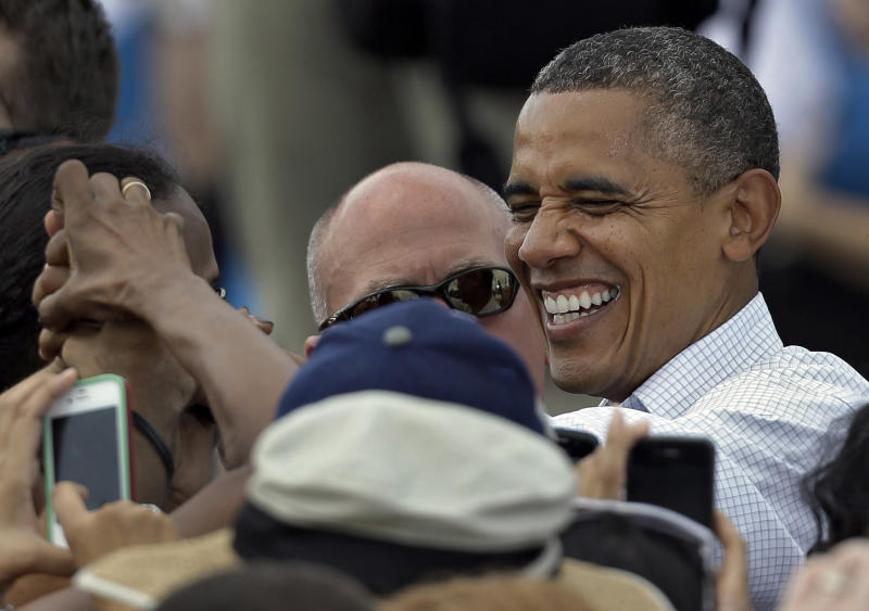 President Obama laughs as he greets supporters after speaking at a campaign rally Saturday, Sept. 8, 2012, in Seminole, Fla. (AP Photo/Chris O'Meara)