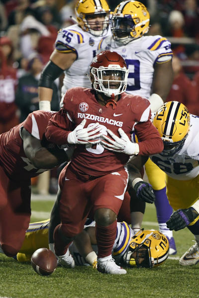 FILE - In this Nov. 10, 2018, file photo, Arkansas defensive back De'Jon Harris celebrates after a tackle against LSU during the second half of an NCAA college football game in Fayetteville, Ark. The Razorbacks did not win an SEC game in coach Chad Morris first season, but Harris was one of the best _ and busiest _ linebackers in the conference. Harris led the SEC in tackles with 118. (AP Photo/Michael Woods, File)