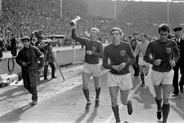 Hurst (right) will always be remembered for his Wembley hat-trick in 1966