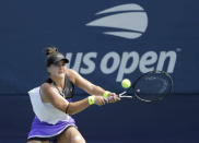 FILE - In this Aug, 27, 2019, file photo, Bianca Andreescu, of Canada, returns a shot to Katie Volynets, of the United States, during the first round of the US Open tennis tournament in New York. Reigning U.S. Open champion Bianca Andreescu pulled out of the Grand Slam tournament Thursday, Aug. 13, 2020, saying the coronavirus pandemic prevented her from properly preparing for competition. (AP Photo/Frank Franklin II, File)