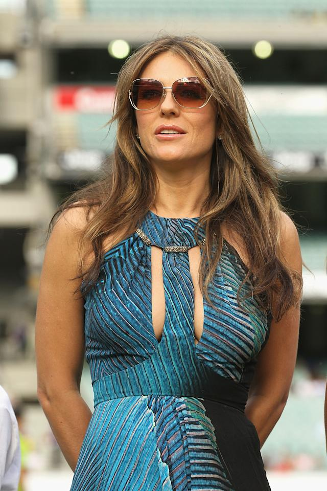 MELBOURNE, AUSTRALIA - DECEMBER 17:  Liz Hurley walks out to toss the coin ahead of the T20 Big Bash League match between the Melbourne Stars and the Sydney Thunder at Melbourne Cricket Ground on December 17, 2011 in Melbourne, Australia.  (Photo by Hamish Blair/Getty Images)