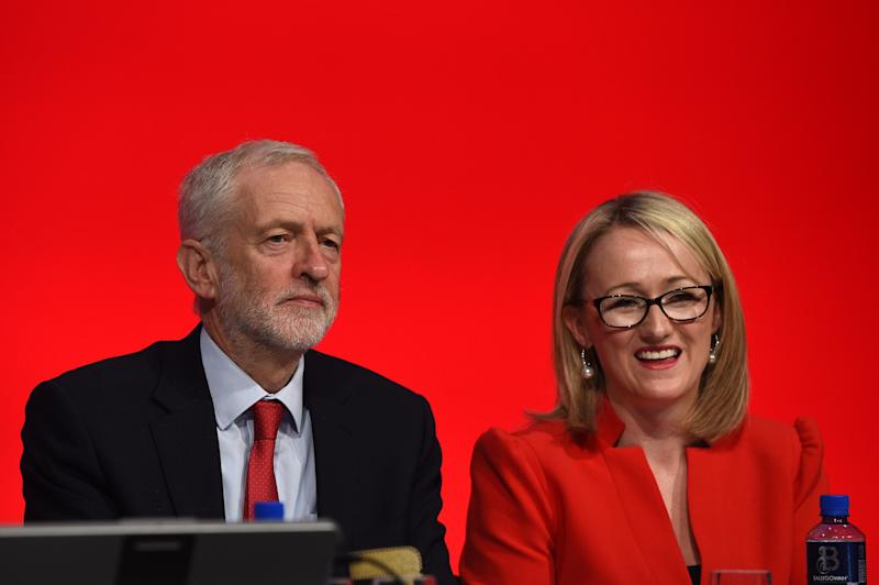 Opposition Labour party shadow Business secretary Rebecca Long-Bailey (R) smiles by leader Jeremy Corbyn after addressing delegates on the third day of the Labour party conference in Liverpool, north west England on September 25, 2018. (Photo by Oli SCARFF / AFP) (Photo credit should read OLI SCARFF/AFP/Getty Images)