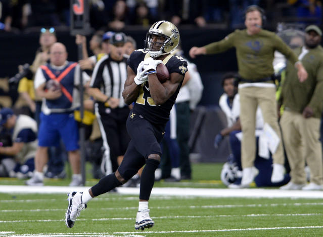 New Orleans Saints wide receiver Michael Thomas (13) pulls in a 72 yard touchdown reception in the second half of an NFL football game against the Los Angeles Rams in New Orleans, Sunday, Nov. 4, 2018. (AP Photo/Bill Feig)