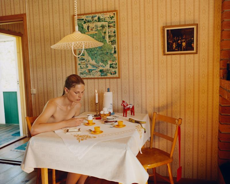 Adela eating an egg in the cabin. Notice the regional map of Dalarna hanging on the wall. Also the little wooden toy horse on the table, a typical Dalecarlian artifact.