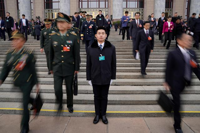 <p>Security personnel stand guard in front of the Great Hall of the People after the second plenary session of the National People's Congress (NPC) in Beijing on March 9, 2018. (Photo: Jason Lee/Reuters) </p>