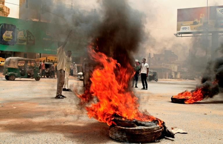 Sudanese protesters burn tyres during a demonstration in Omdurman, the capital's twin city
