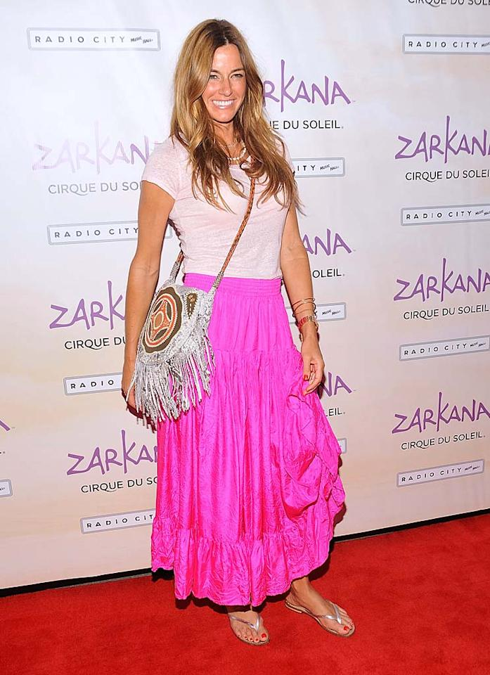 "LuAnn's ""Real Housewives"" co-star, Kelly Bensimon, delivered her own fashion faux pas this week by attending the premiere of Cirque du Soleil's ""Zarkana"" in a chintzy-looking shirt, even-cheaper-looking skirt, and flip-flops. Gary Gershoff/<a href=""http://www.wireimage.com"" target=""new"">WireImage.com</a> - June 29, 2011"