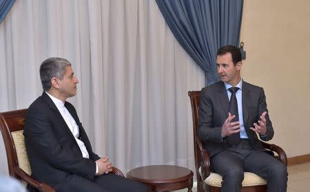 Syria's President Bashar al-Assad (R) meets Iranian Minister of Economy and Finance Ali Tayebnia in Damascus March 16, 2015, in this picture released by Syria's national news agency SANA. REUTERS/SANA/Handout via Reuters