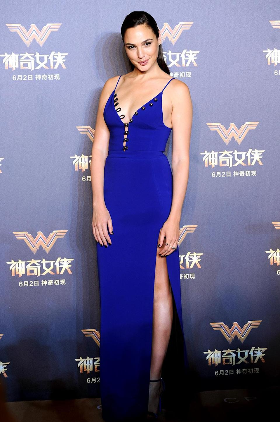 <p>At the Chinese premiere of <i>Wonder Woman</i>, Gadot broke out a sexy V-neck gown by David Koma. Fun fact: Gadot is used to all the wardrobe changes because she was Miss Israel in 2004. (Photo: VCG/VCG via Getty Images) </p>