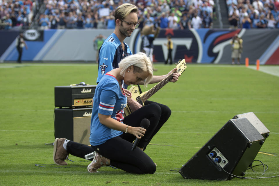 """Meghan Linsey, a former contestant on """"The Voice,"""" kneels after singing the national anthem before the start of the Tennessee Titans and Seattle Seahawks football game at Nissan Stadium in Nashville, Tenn., on Sept. 24, 2017. (Photo: Ryan Hermens/The Paducah Sun via AP)"""