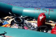 A rubber boat holds belongings left by African migrants after being rescued by the MV Geo Barents vessel of MSF (Doctors Without Borders), off Libya in the central Mediterranean route, Monday, Sept. 20, 2021. (AP Photo/Ahmed Hatem)