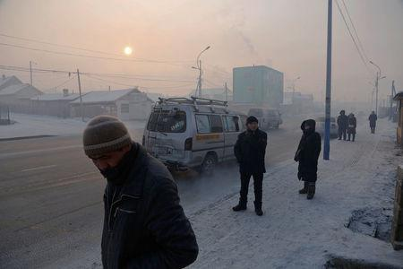 People commute in an industrial area on a cold day in Ulaanbaatar, Mongolia, January 19, 2017. REUTERS/B. Rentsendorj