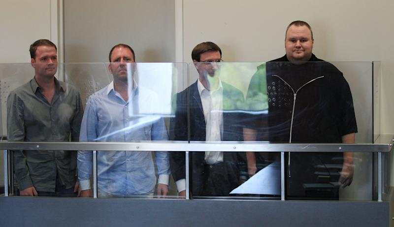 Megaupload.com employees Bram van der Kolk, also known as Bramos, left, Finn Batato,second from left,  Mathias Ortmann and founder, former CEO and current chief innovation officer of Megaupload.com Kim Dotcom (also known as Kim Schmitz and Kim Tim Jim Vestor), right, appear in North Shore District Court in Auckland, New Zealand, Friday, Jan. 20, 2012. The four appeared in court in relation to arrests made to Megaupload.com, which is linked to a U.S. investigation into international copyright infringement and money laundering. (AP Photo/Greg Bowker, New Zealand Herald) NEW ZEALAND OUT, AUSTRALIA OUT
