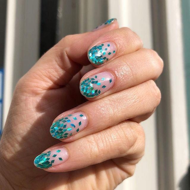 """<p>Work those Ariel vibes with this simple (but stunning) teal glitter fade.</p><p><a href=""""https://www.instagram.com/p/BxJI4t4HsHS/"""" rel=""""nofollow noopener"""" target=""""_blank"""" data-ylk=""""slk:See the original post on Instagram"""" class=""""link rapid-noclick-resp"""">See the original post on Instagram</a></p>"""