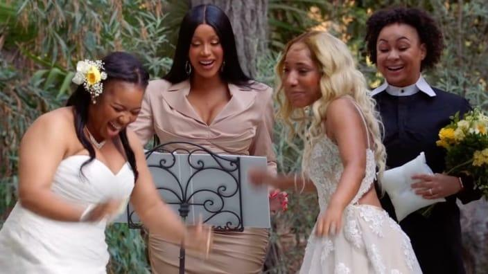 """In a surprise wedding ceremony on Monday's """"Cardi Tries___"""" episode, (from left) bride Brandi Taylor, rap star/officiant Cardi B, bride Shannon Herbert and ring bearer Raven-Symoné share a sweet moment. (Photo: Facebook)"""
