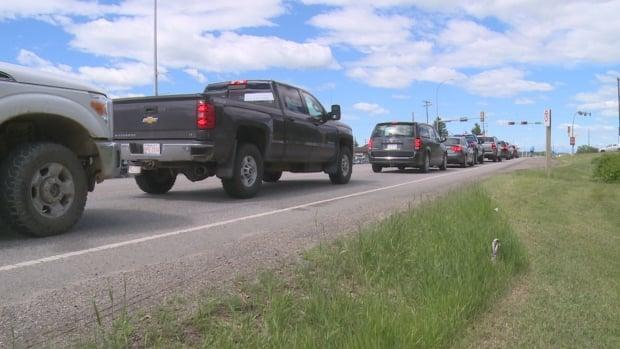 Traffic backs up on Highway 1A on Friday, as the Town of Cochrane and the province broke ground on a revamp of the road.  (Helen Pike/CBC - image credit)