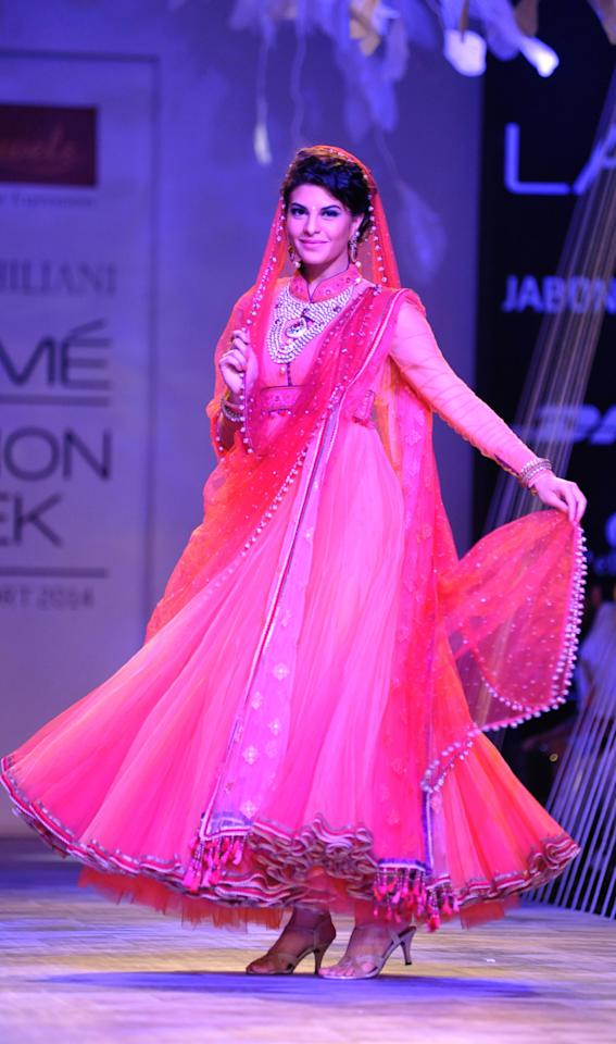 Jacqueline Fernandez showcases a creation by designer Tarun Tahiliani on the second day of the Lakme Fashion Week (LFW) in Mumbai on March 12, 2014.
