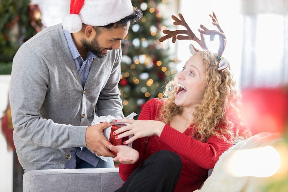 """<p>If you have a big family, get everyone involved in a funny White Elephant game. There's no doubt you're in for a night of laughs with fun <a href=""""https://www.countryliving.com/shopping/news/g4861/best-gag-gifts/"""" rel=""""nofollow noopener"""" target=""""_blank"""" data-ylk=""""slk:gag gifts"""" class=""""link rapid-noclick-resp"""">gag gifts</a> or <a href=""""https://www.countryliving.com/shopping/gifts/g25632110/gift-card-ideas/"""" rel=""""nofollow noopener"""" target=""""_blank"""" data-ylk=""""slk:Christmas gift cards"""" class=""""link rapid-noclick-resp"""">Christmas gift cards</a> that'll have everyone stealing gifts left and right.</p><p><a class=""""link rapid-noclick-resp"""" href=""""https://www.amazon.com/Christmas-Holiday-Comfort-Thicken-Supplies/dp/B0989C1LNK/ref=sr_1_4?dchild=1&keywords=santa+hat&qid=1632338516&sr=8-4&tag=syn-yahoo-20&ascsubtag=%5Bartid%7C10050.g.25411840%5Bsrc%7Cyahoo-us"""" rel=""""nofollow noopener"""" target=""""_blank"""" data-ylk=""""slk:SHOP SANTA HATS"""">SHOP SANTA HATS</a></p>"""