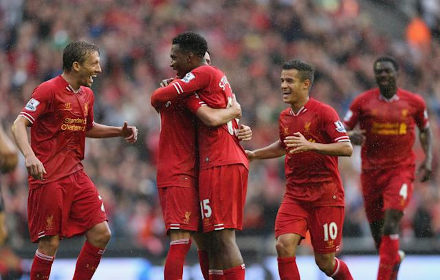 LIVERPOOL, ENGLAND - AUGUST 17: Daniel Sturridge of Liverpool is congratulated by Iago Aspas,Lucas,Philuppe Coutinho and Kolo Toure after scoring the first goal during the Barclays Premier League match between Liverpool and Stoke City at Anfield on August 17, 2013 in Liverpool, England. (Photo by Clive Brunskill/Getty Images)