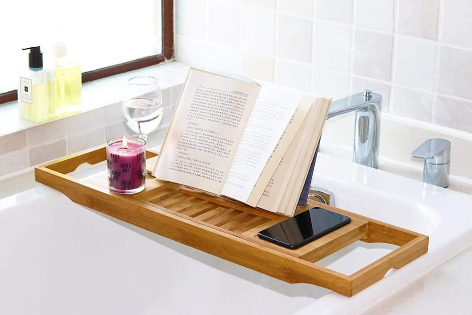 <p>C'mon, you know you want this <span>Dozyant Bamboo Bathtub Caddy</span> ($27, originally $30). Who doesn't want to make bath time even more relaxing?</p>