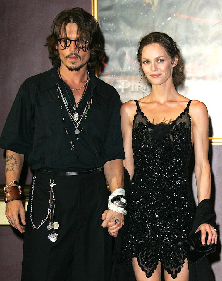 """Johnny Depp and longtime love Vanessa Paradis, with whom he has children Lily-Rose, 13, and Jack, 10, revealed in June that they'd called it quits after 14 years — an incredibly impressive length of time in Hollywood. The romance fizzled after they recently relocated from France to L.A. and began living separate lives, sources told <a target=""""_blank"""" href=""""http://www.people.com/people/article/0,,20562207,00.html"""">People</a>. Were you sad to see their relationship end? (7/6/2006)"""