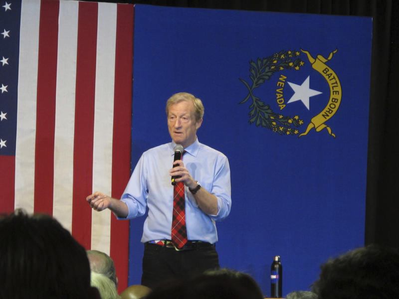 """In this Tuesday, Feb. 11, 2020, photo, Democratic presidential hopeful Tom Steyer speaks to about 200 people during a town hall gathering at the National Automobile Museum, in Reno, Nev. The California billionaire says his campaign is """"doing fine"""" despite dismal showings in Iowa and New Hampshire, but has to do """"very well"""" in the Nevada caucuses next up Feb. 22. (AP Photo/Scott Sonner)"""