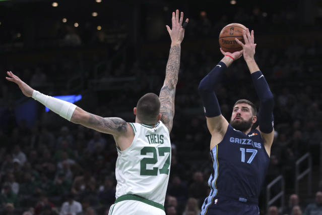 Memphis Grizzlies center Jonas Valanciunas (17) shoots over Boston Celtics forward Daniel Theis (27) during the first half of an NBA basketball game in Boston, Wednesday, Jan. 22, 2020. (AP Photo/Charles Krupa)