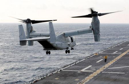 A MV-22 Osprey ferrying an initial group of Marines bound for islands ravaged by Hurricane Maria takes off at sunrise from the flight deck of the USS Kearsarge as operations to assist hurricane-ravaged St. Croix and Puerto Rico begin, in the Caribbean Sea, September 21, 2017.  REUTERS/Jonathan Drake