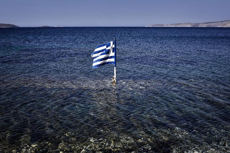 The International Monetary Fund said it would not join a new bailout program for Greece until conditions for debt sustainability, including debt relief and economic reforms, are clearly assured (AFP Photo/Louisa Gouliamaki)