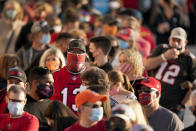 FILE - In this Feb. 4, 2021, file photo, people wait in line for an exhibit at the NFL Experience in Tampa, Fla. The city is hosting Sunday's Super Bowl football game between the Tampa Bay Buccaneers and the Kansas City Chiefs. (AP Photo/Charlie Riedel, File)