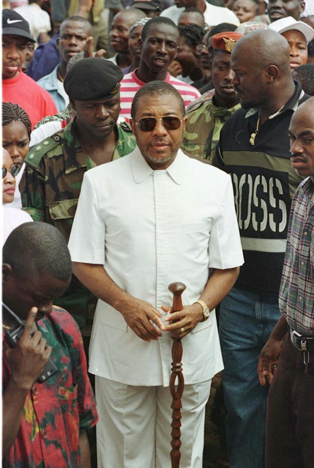 Liberian Presidential candidate and warlord Charles Taylor arrives at a polling center before voting Saturday July 19, 1997.  Taylor took a seemingly insurmountable lead Monday July 21st with more than a third of presidential ballots counted, but his chief rival complained of widespread voting fraud.  (AP Photo/David Guttenfelder)