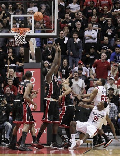San Diego State's Jamaal Franklin (21) falls as he watches his shot go in the basket to win the game against UNLV in the final seconds of the second half during an NCAA college basketball game Saturday, Jan. 14, 2012, in San Diego. San Diego State won 69-67. (AP Photo/Gregory Bull)