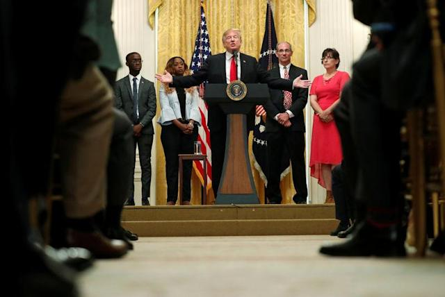 U.S. President Donald Trump holds a news conference to mark six months since the passage of the Tax Cuts and Jobs Act, in the White House East Room in Washington, U.S., June 29, 2018. REUTERS/Kevin Lamarque/File Photo