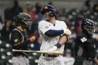 Milwaukee Brewers' Keston Hiura reacts after being hit by a pitch during the third inning of a baseball game against the Pittsburgh Pirates Friday, April 16, 2021, in Milwaukee. (AP Photo/Morry Gash)