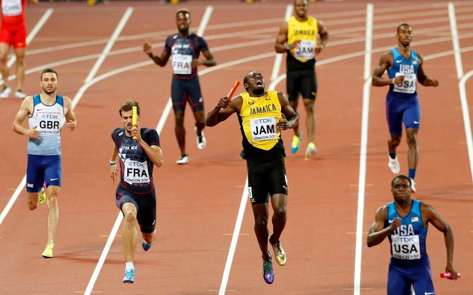 Usain Bolt collapses with a hamstring injury - REUTERS