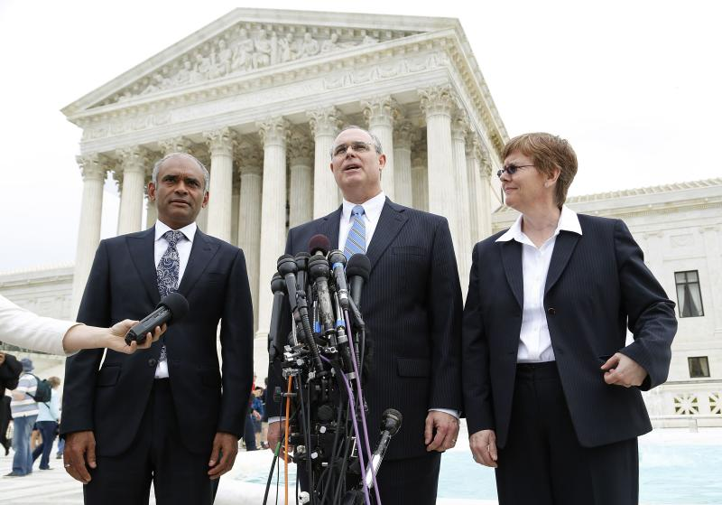 Kanojia stands before reporters with Frederick and Cotter as they depart the U.S. Supreme Court in Washington
